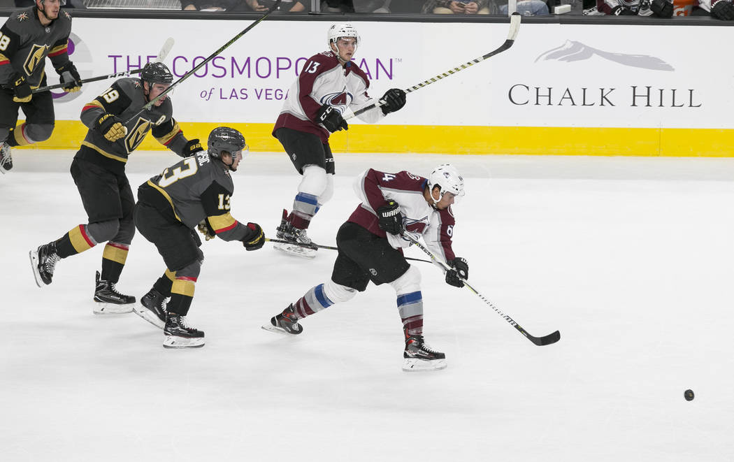 Colorado Avalanche right wing Nail Yakupov (64) takes a slap shot after breaking away from Vegas Golden Knights right wing Reilly Smith (19) and Vegas Golden Knights left wing Brendan Leipsic (13) ...