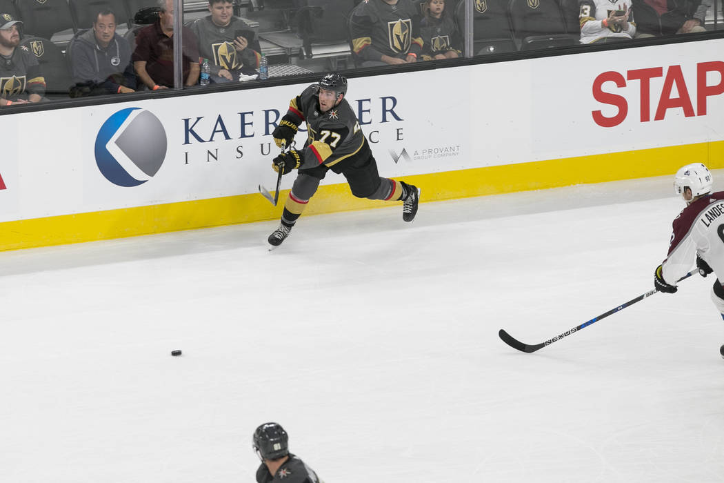 Vegas Golden Knights defenseman Brad Hunt (77) passes the puck during the first period of a preseason NHL hockey game between the Vegas Golden Knights and the Colorado Avalanche on Thursday, Sept. ...