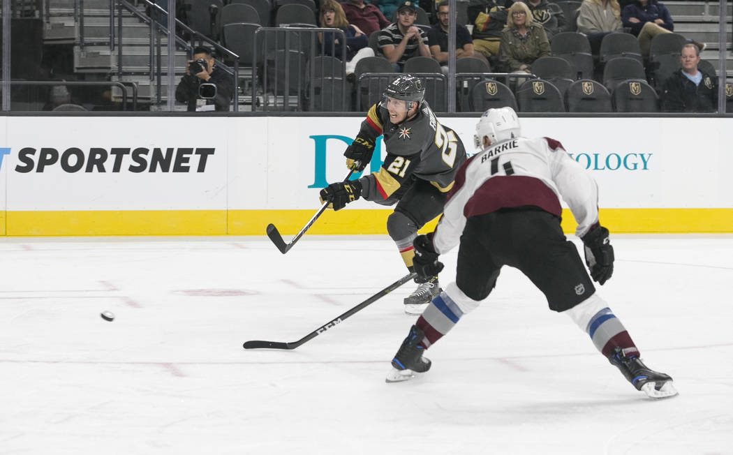 Vegas Golden Knights center Cody Eakin (21) takes shot past Colorado Avalanche defenseman Tyson Barrie (4) during the second period of a preseason NHL hockey game between the Vegas Golden Knights  ...