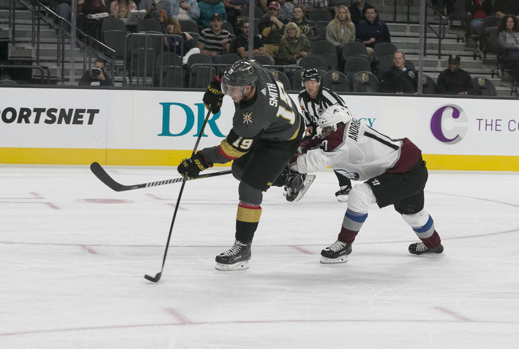 Vegas Golden Knights right wing Reilly Smith (19) shoots past Colorado Avalanche right wing Sven Andrighetto (10) during the second period of a preseason NHL hockey game between the Vegas Golden K ...