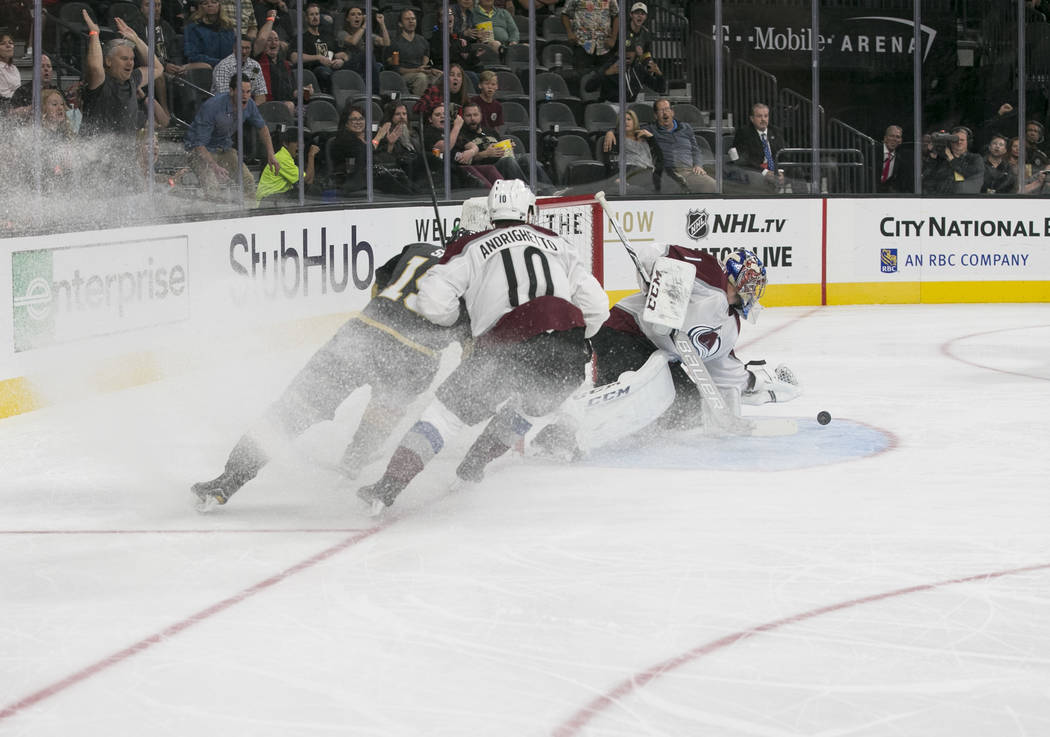 Colorado Avalanche goalie Semyon Varlamov, right, (1) blocks a shot from Vegas Golden Knights right wing Reilly Smith, left, (19) during the second period of a preseason NHL hockey game between th ...