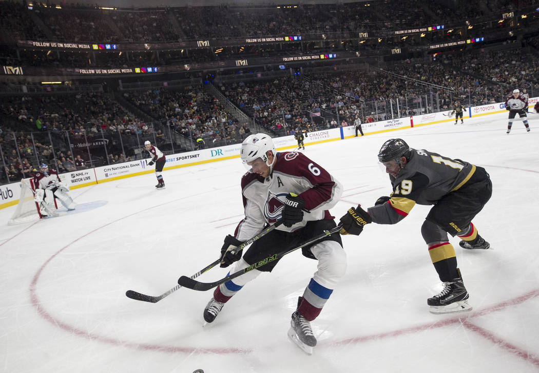 Colorado Avalanche defenseman Erik Johnson (6) and Vegas Golden Knights right wing Reilly Smith (19) vie for the puck during the second period of a preseason NHL hockey game between the Vegas Gold ...