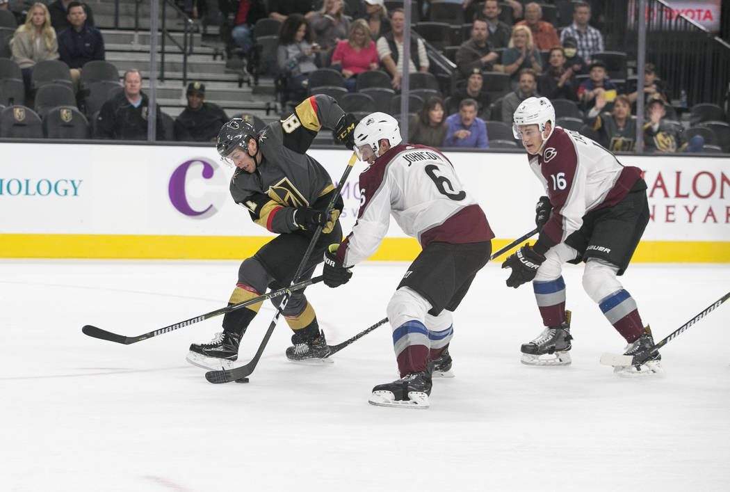 Vegas Golden Knights center Jonathan Marchessault (81) is chased by Colorado Avalanche defenseman Erik Johnson (6) and defenseman Nikita Zadorov (16) during the second period of a preseason NHL ho ...
