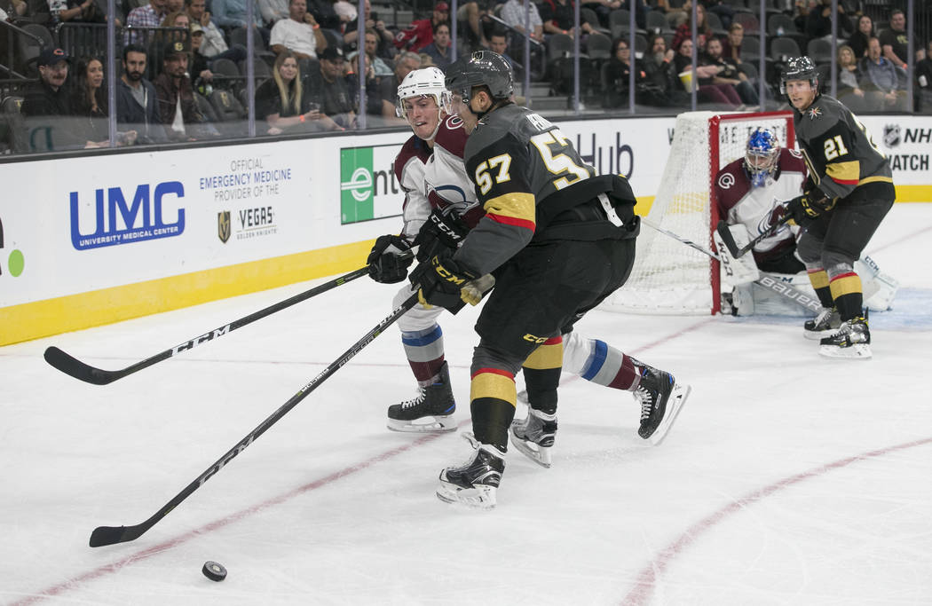 Colorado Avalanche defenseman Tyson Barrie (4) and Vegas Golden Knights left wing David Perron (57) vie for the puck during the second period of a preseason NHL hockey game between the Vegas Golde ...