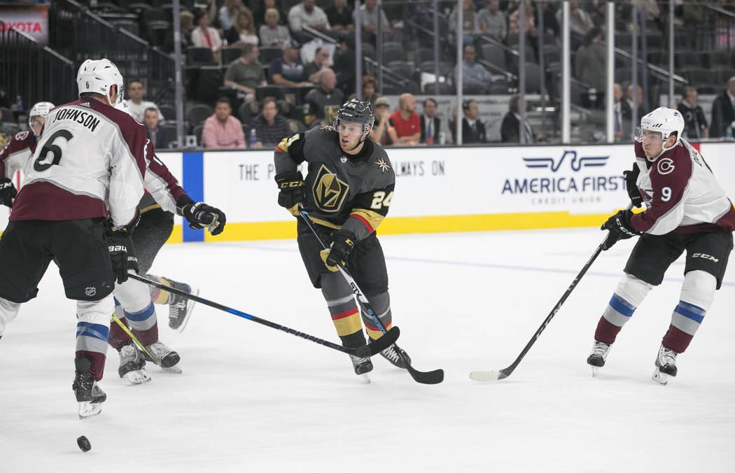 Vegas Golden Knights center Oscar Lindberg (24) looks to pass through Colorado Avalanche defenseman Erik Johnson (6) and center Matt Duchene (9) during the second period of a preseason NHL hockey  ...