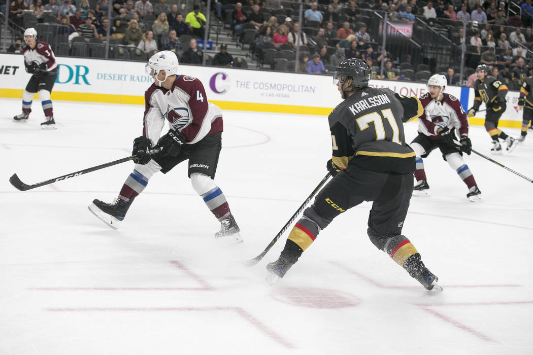 Vegas Golden Knights center William Karlsson (71) shoot past Colorado Avalanche defenseman Tyson Barrie (4) during the second period of a preseason NHL hockey game between the Vegas Golden Knights ...
