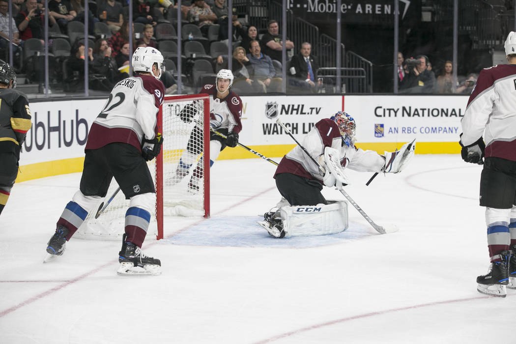 Colorado Avalanche goalie Semyon Varlamov (1) blocks a shot from Vegas Golden Knights center William Karlsson (71) during the second period of a preseason NHL hockey game between the Vegas Golden  ...