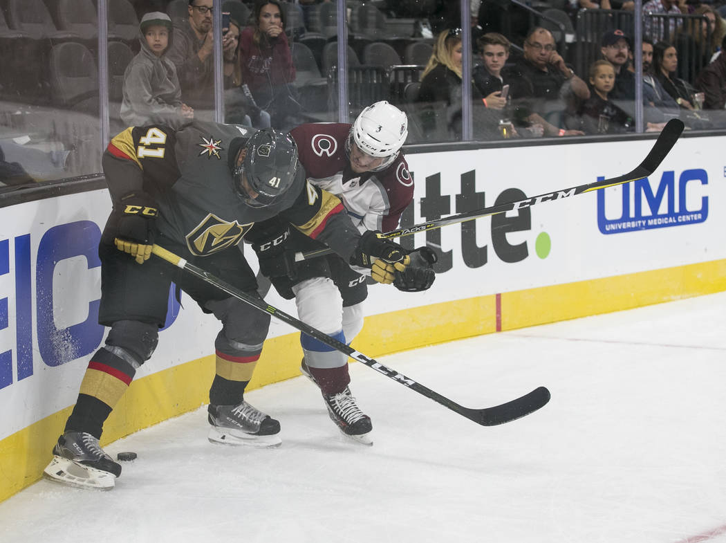 Vegas Golden Knights right wing Pierre-Edouard Bellemare (41) and Colorado Avalanche defenseman Chris Bigras (3) vie for the puck during the second period of a preseason NHL hockey game between th ...