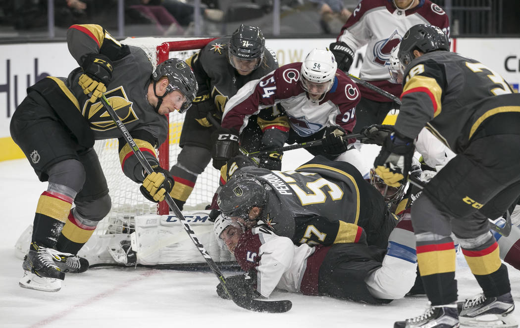 Vegas Golden Knights' Oscar Lindberg (24) William Karlsson (71) David Perron (57) and Tomas Hyka (38) scramble for the puck during the second period of a preseason NHL hockey game between the Vega ...