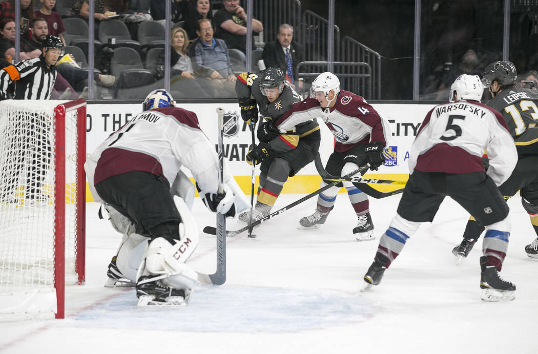 Vegas Golden Knights center Oscar Lindberg (24) looks for a shot through Colorado Avalanche defenseman Tyson Barrie (4) during the second period of a preseason NHL hockey game between the Vegas Go ...