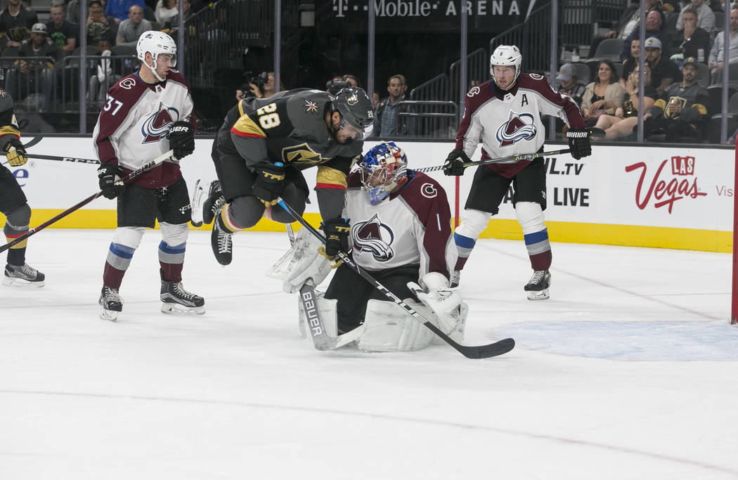 Vegas Golden Knights left wing William Carrier (28) collides with Colorado Avalanche goalie Semyon Varlamov (1) during the third period of a preseason NHL hockey game between the Vegas Golden Knig ...