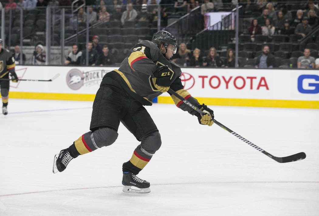 Vegas Golden Knights center William Karlsson (71) takes a slap shot during the third period of a preseason NHL hockey game between the Vegas Golden Knights and the Colorado Avalanche on Thursday,  ...
