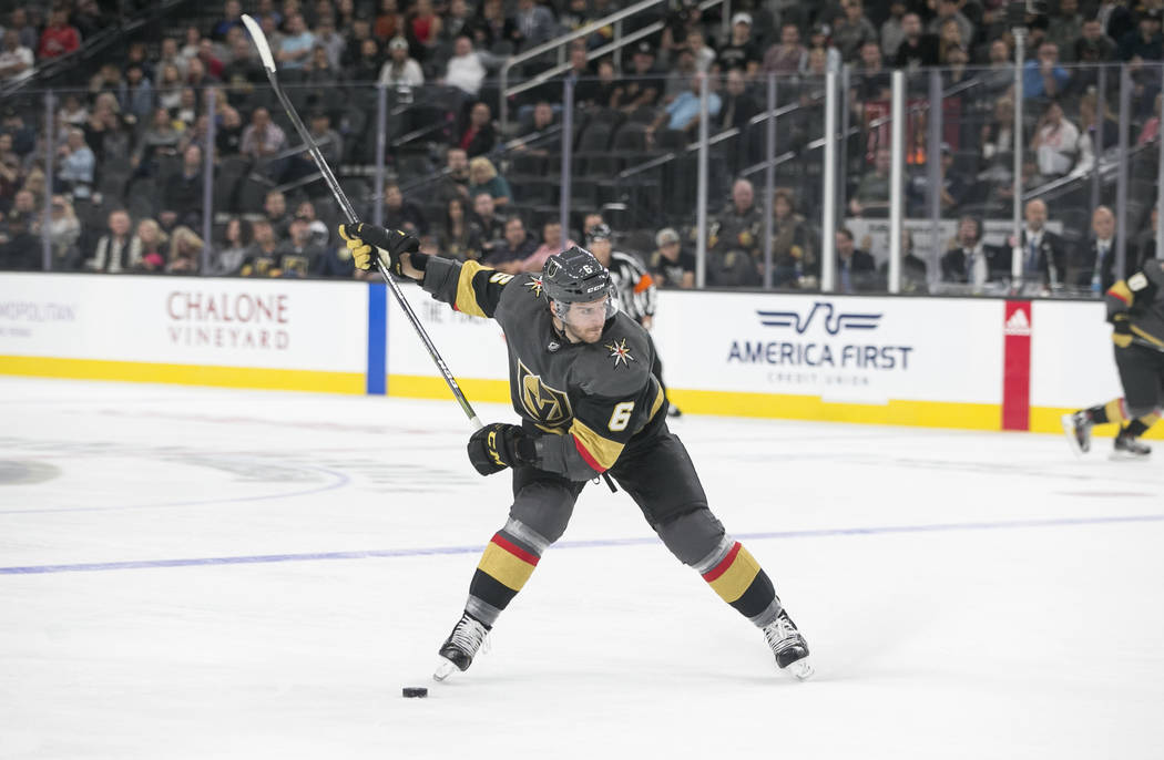 Vegas Golden Knights defenseman Colin Miller (6) takes a slap shot during the third period of a preseason NHL hockey game between the Vegas Golden Knights and the Colorado Avalanche on Thursday, S ...