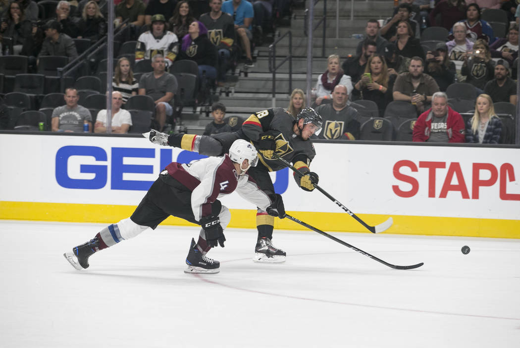 Vegas Golden Knights defenseman Nate Schmidt (88) is pressured by Colorado Avalanche defenseman Tyson Barrie (4) during the third period of a preseason NHL hockey game between the Vegas Golden Kni ...