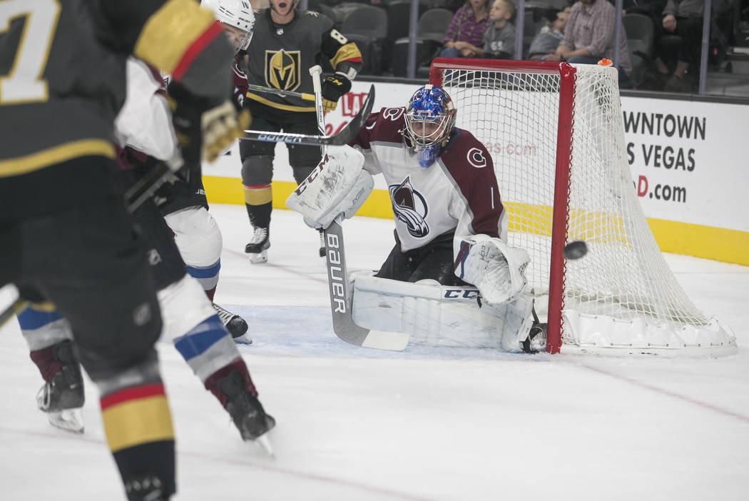 Colorado Avalanche goalie Semyon Varlamov (1) keeps his eye on the puck during the third period of a preseason NHL hockey game between the Vegas Golden Knights and the Colorado Avalanche on Thursd ...