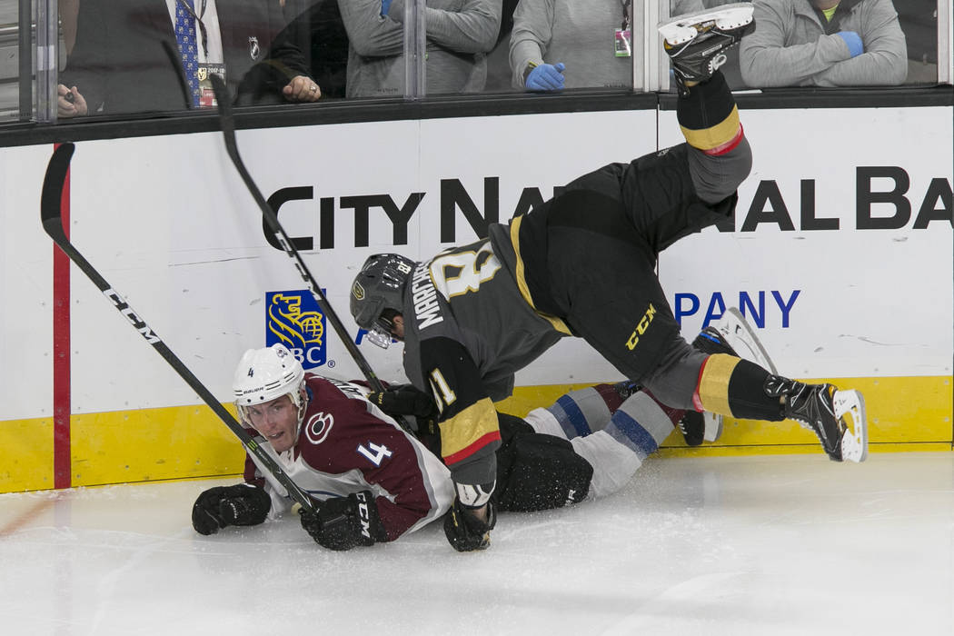 Colorado Avalanche defenseman Tyson Barrie (4) and Vegas Golden Knights center Jonathan Marchessault (81) fall to the ice during the first period of a preseason NHL hockey game, Thursday, Sept. 28 ...