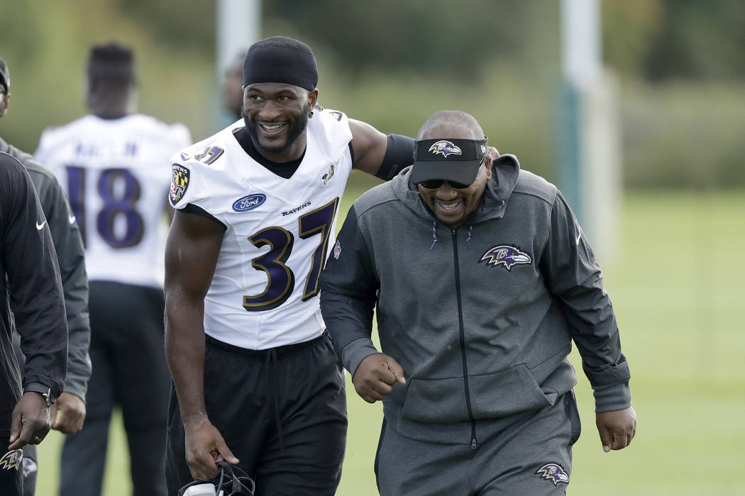 Baltimore Ravens running back Javorius Allen, left, walks off the field of play after taking part in a practice session at London Irish training ground in London, England, Friday, Sept. 22, 2017.  ...