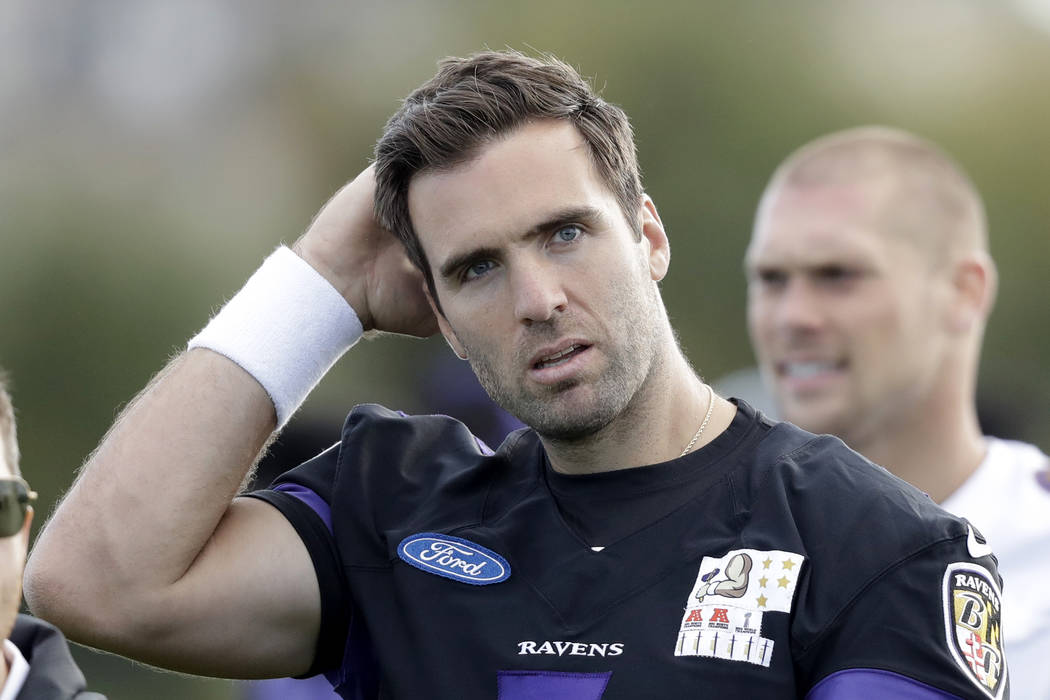 Baltimore Ravens quarterback Joe Flacco walks off the field at the end of a practice session at London Irish training ground in London, England, Friday, Sept. 22, 2017. Baltimore Ravens are due to ...
