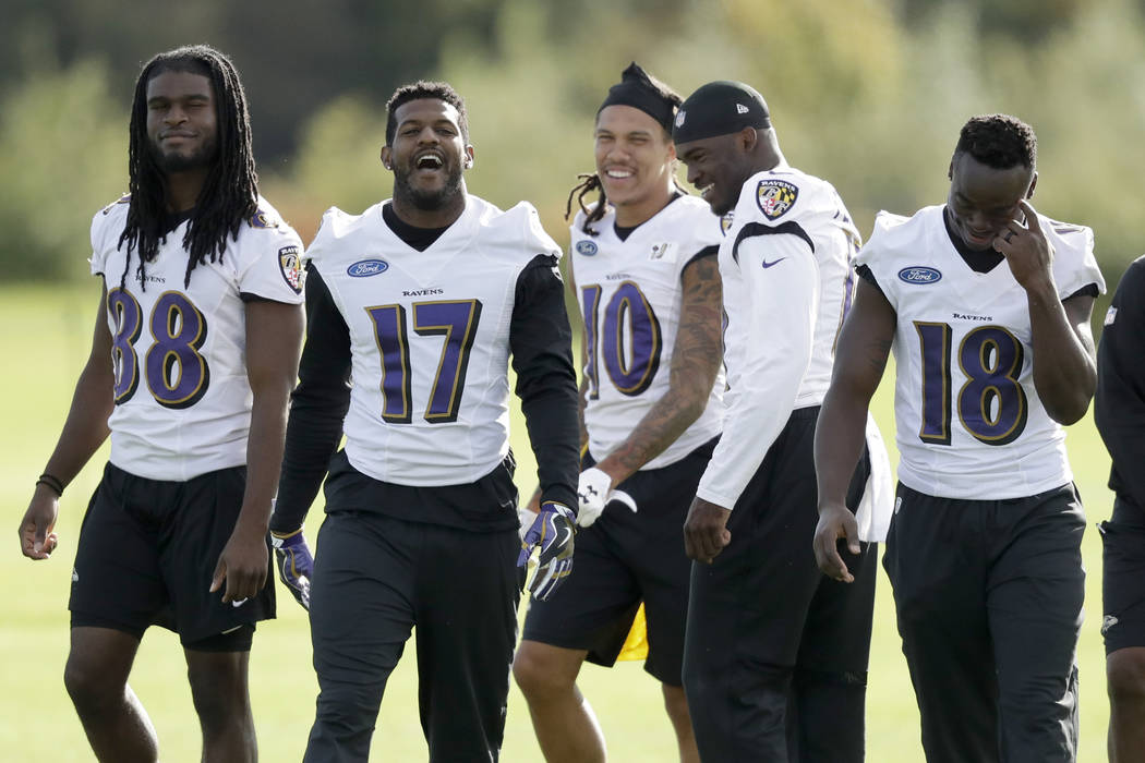 Baltimore Ravens, from second left, wide receivers 17 Mike Wallace, 10 Chris Moore, 11 Breshad Perriman and 18 Jeremy Maclin leave the field at the end of a practice session at London Irish traini ...