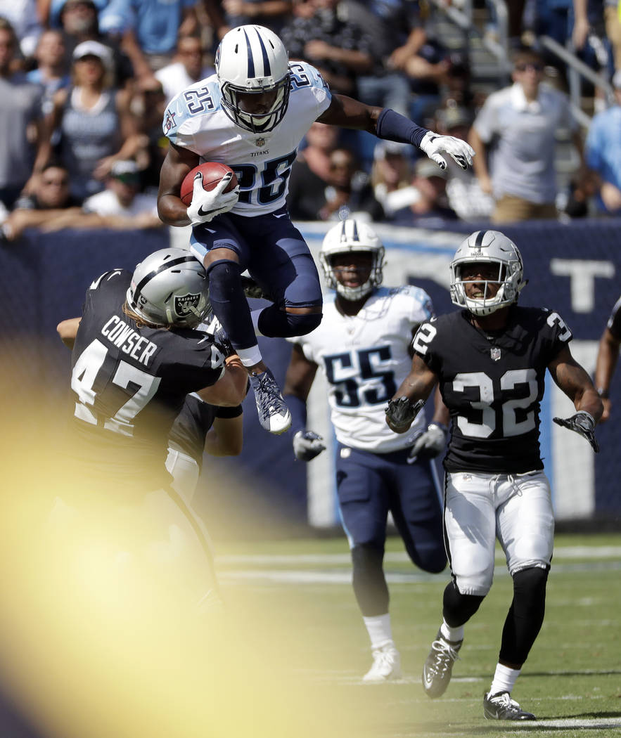 Tennessee Titans' Adoree' Jackson (25) leaps over Oakland Raiders defender James Cowser (47) as Jackson returns a kickoff in the second half of an NFL football game Sunday, Sept. 10, 2017, in Nash ...