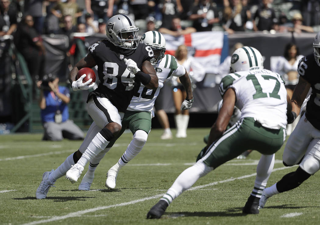 Oakland Raiders' Cordarrelle Patterson returns a kickoff during the first half of an NFL football game against the New York Jets in Oakland, Calif., Sunday, Sept. 17, 2017. (AP Photo/Marcio Jose S ...