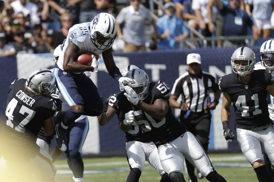 Tennessee Titans' Adoree' Jackson (25) leaps past Oakland Raiders defender James Cowser (47) and Nicholas Morrow (50) as Jackson returns a kickoff in the second half of an NFL football game Sunday ...