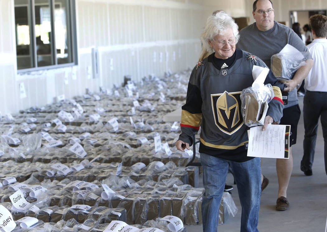 KJ Howe, Golden Knights season ticket holder, leaves City National Center after receiving an exclusive membership kit and team's home jersey with commemorative items celebrating the team's  ...