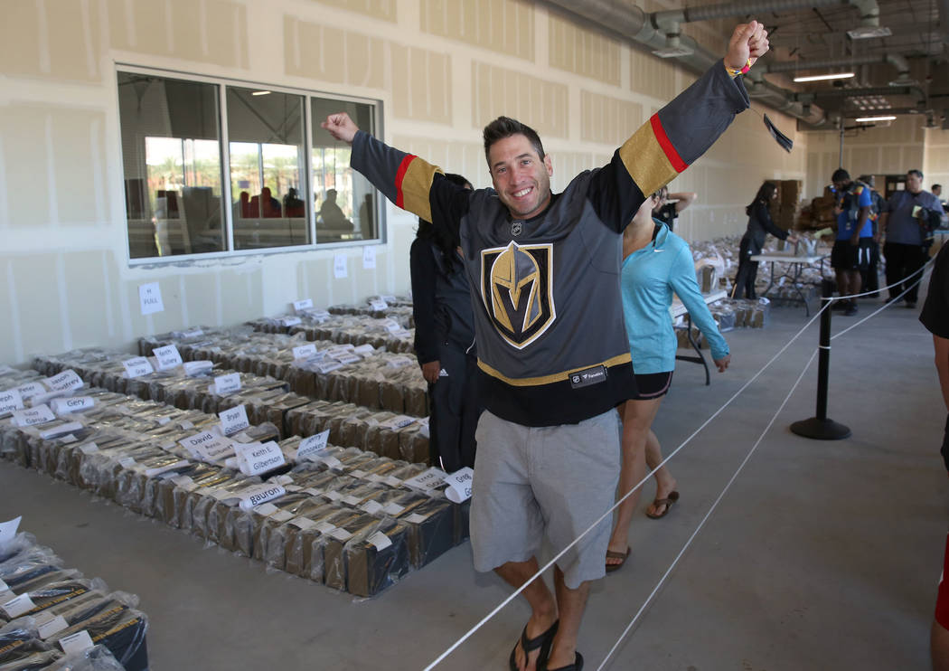 Rich Belsky, Golden Knights season ticket holder, reacts after receiving an exclusive team's home jersey during season ticket members jersey pick up event at City National Center on Friday, Sept.  ...