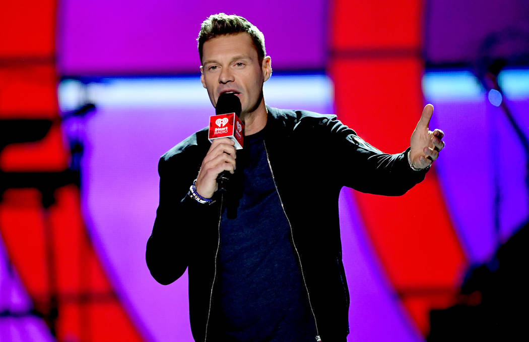 LAS VEGAS, NV - SEPTEMBER 22:  Ryan Seacrest speaks onstage during the 2017 iHeartRadio Music Festival at T-Mobile Arena on September 22, 2017 in Las Vegas, Nevada.  (Photo by Kevin Winter/Getty I ...