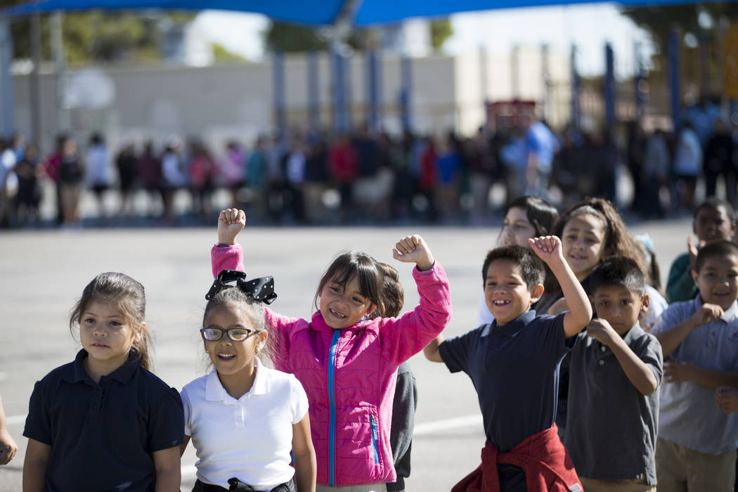 Students at Dailey Elementary School during a book giveaway at their school in Las Vegas, Friday, Sept. 22, 2017. Better World Books donated 1,200 books that were transported by a fleet of bicycli ...