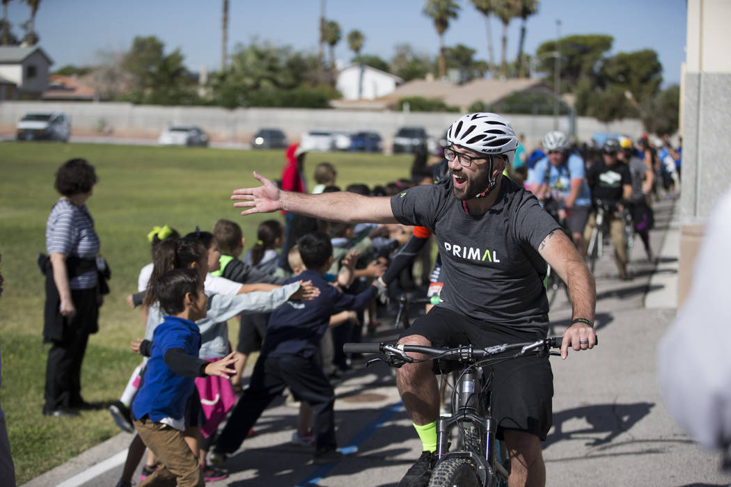 Steve Blackband arrives to Dailey Elementary School for a book giveaway for students, in Las Vegas, Friday, Sept. 22, 2017. Better World Books donated 1,200 books that were transported by a fleet  ...
