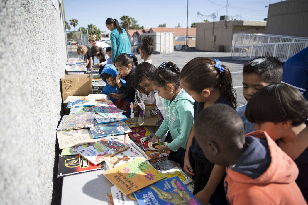 Students at Dailey Elementary School during a book giveaway, in Las Vegas, Friday, Sept. 22, 2017. Better World Books donated 1,200 books that were transported by a fleet of bicyclists to the scho ...