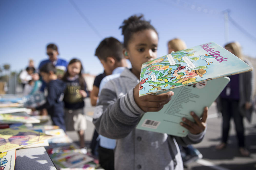 "Clyde ""Trey"" Willis, 7, student at Dailey Elementary School during a book giveaway at his school in Las Vegas, Friday, Sept. 22, 2017. Better World Books donated 1,200 books that ..."