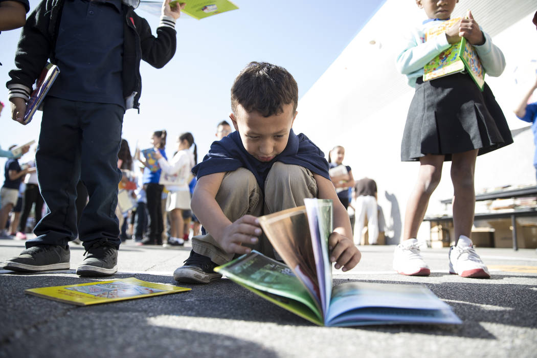 Doryean Esparza, 6, student at Dailey Elementary School during a book giveaway at his school in Las Vegas, Friday, Sept. 22, 2017. Better World Books donated 1,200 books that were transported by a ...