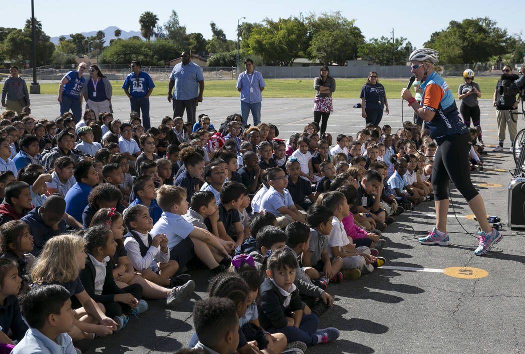 Safe Routes to School Coordinator Traci Traasdahl, right, speaks to Dailey Elementary School students during a book giveaway at the school on Friday, Sept. 22, 2017, in Las Vegas. Better World Boo ...