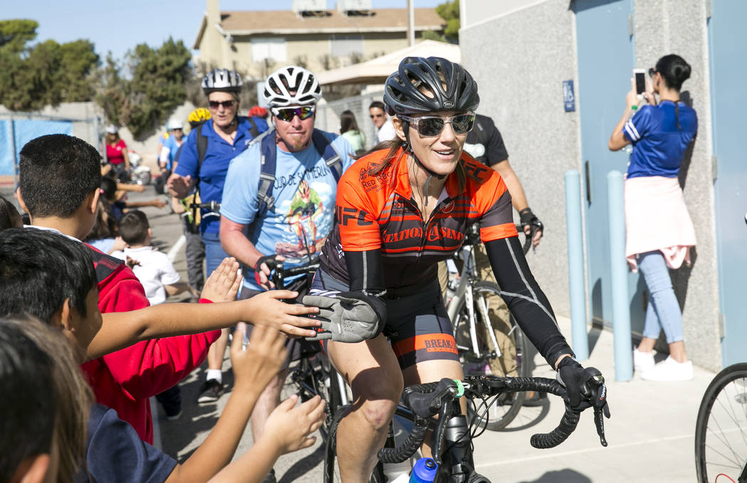 Southern Nevada Bicycle Coalition President Keely Brooks is greeted by students as she arrives at Dailey Elementary School for a book giveaway on Friday, Sept. 22, 2017, in Las Vegas. Better World ...