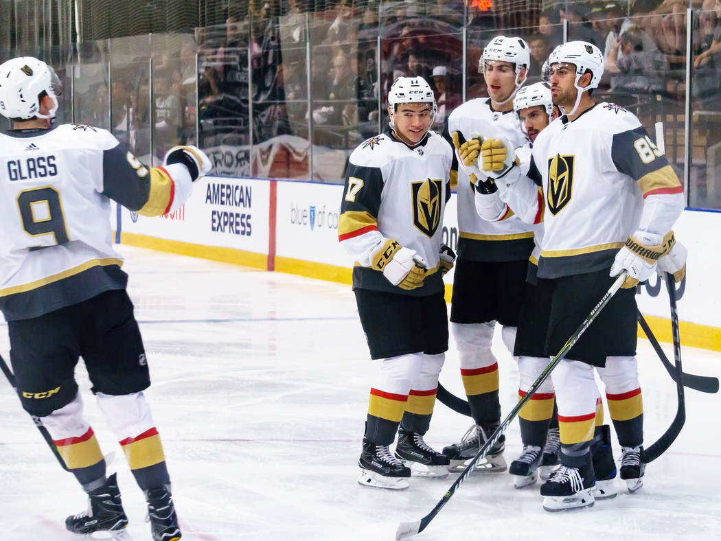 Golden Knights teammates wait to congratulate Cody Glass (9) after he scored in the first period of a rookies' hockey game against Los Angles Kings in El Segundo, Calf., Wednesday, Sept. 13, 2017. ...