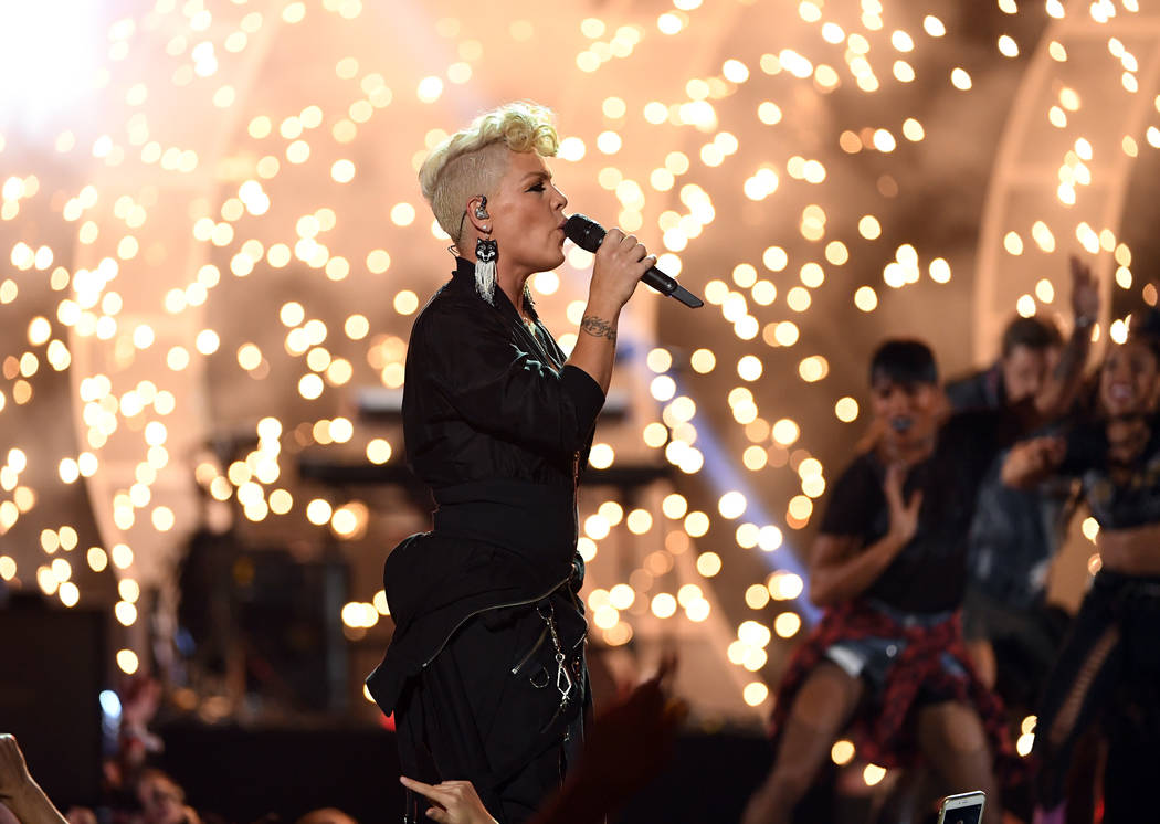 LAS VEGAS, NV - SEPTEMBER 22:  Pink performs onstage during the 2017 iHeartRadio Music Festival at T-Mobile Arena on September 22, 2017 in Las Vegas, Nevada.  (Photo by Kevin Winter/Getty Images f ...