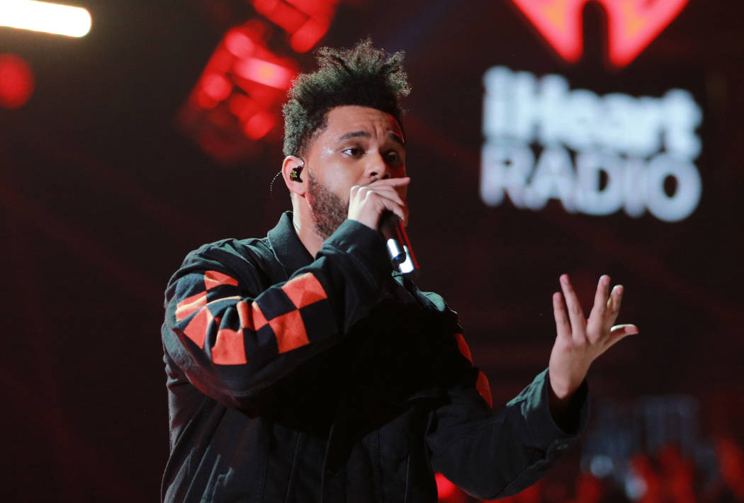 LAS VEGAS, NV - SEPTEMBER 22:  The Weeknd performs onstage during the 2017 iHeartRadio Music Festival at T-Mobile Arena on September 22, 2017 in Las Vegas, Nevada.  (Photo by Rich Fury/Getty Image ...