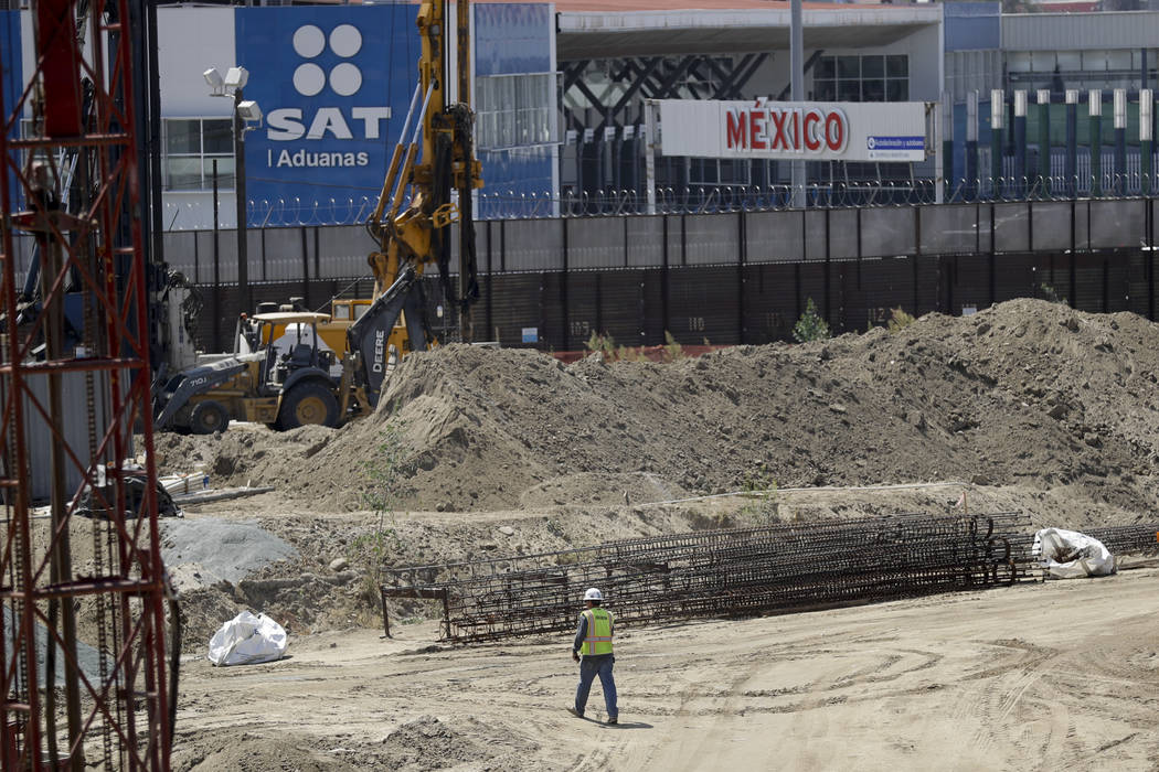 In this Tuesday, Sept. 19, 2017 photo, construction continues on a new curve along California's Interstate 5, as it approaches the border with Tijuana, Mexico, in San Diego. (AP Photo/Gregory Bull)