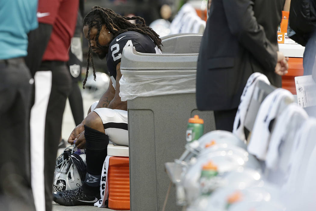Oakland Raiders running back Marshawn Lynch sits on the bench during the national anthem before an NFL preseason football game between the Raiders and the Los Angeles Rams in Oakland, Saturday, Au ...