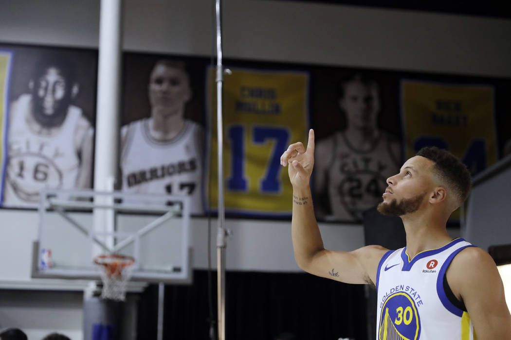 Golden State Warriors' Stephen Curry poses for photos during NBA basketball team media day Friday, Sept. 22, 2017, in Oakland, Calif. (AP Photo/Marcio Jose Sanchez)