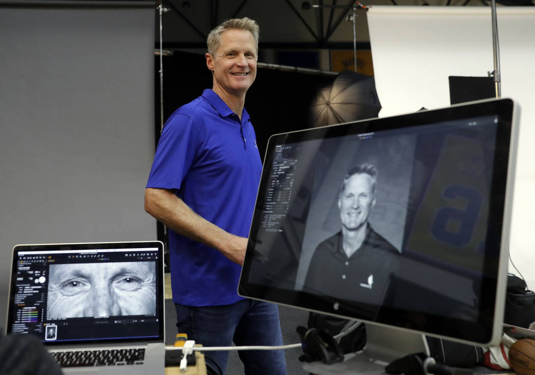 Golden State Warriors head coach Steve Kerr smiles after posing for photographs during NBA basketball team media day Friday, Sept. 22, 2017, in Oakland , Calif. (AP Photo/Marcio Jose Sanchez)