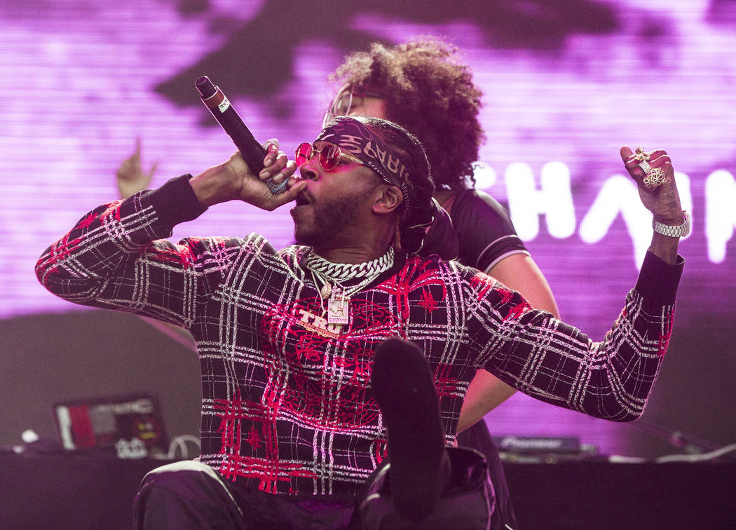 2 Chainz performs during the first day of the Life is Beautiful music and arts festival on Friday, September 22, 2017, in Las Vegas. The Georgia-born rapper completed his set in a wheelchair after ...