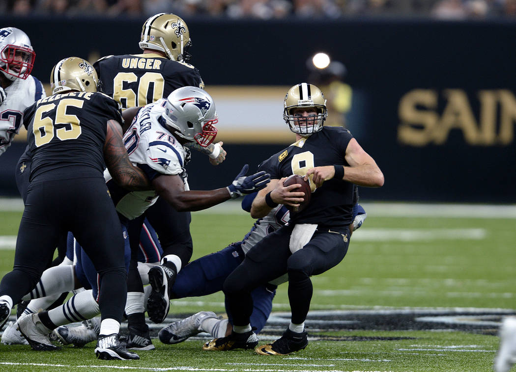 New Orleans Saints quarterback Drew Brees (9) is sacked by New England Patriots defensive end Deatrich Wise as defensive tackle Adam Butler (70) closes in, in the second half of an NFL football ga ...