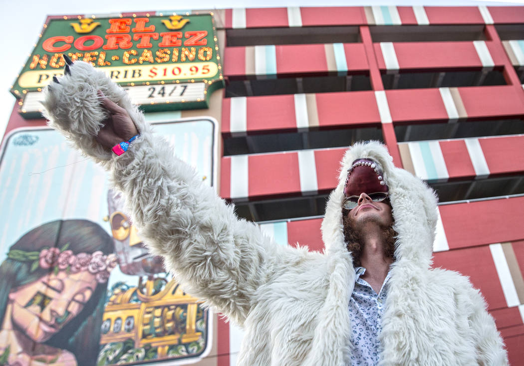 Joseph Valdes gestures at the crowd while wearing his favorite bear coat on 7th Street during the final day of the Life is Beautiful music and arts festival on Sunday, September 24, 2017, in Las V ...