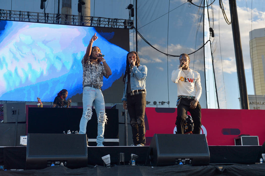 LAS VEGAS, NV - SEPTEMBER 23:  (L-R) Quavo, Takeoff and Offset of Migos perform onstage during the Daytime Village Presented by Capital One at the 2017 HeartRadio Music Festival at the Las Vegas V ...