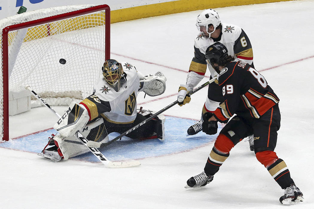 Anaheim Ducks right winger Scott Sabourin (89) scores a goal as Vegas Golden Knights goalie Marc-Andre Fleury (29) and defenseman Colin Miller (6) defend in the second period of an NHL preseason h ...