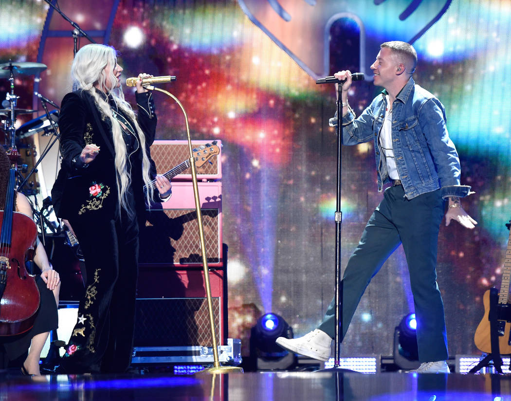 Kesha (L) and Macklemore perform onstage during the 2017 iHeartRadio Music Festival at T-Mobile Arena on September 23, 2017 in Las Vegas, Nevada.  (Photo by David Becker/Getty Images for iHeartMedia)