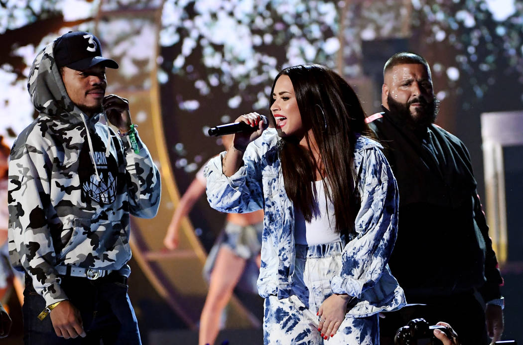 Chance the Rapper, Demi Lovato and DJ Khaled perform onstage during the 2017 iHeartRadio Music Festival at T-Mobile Arena on September 23, 2017 in Las Vegas, Nevada.  (Photo by Kevin Winter/Getty  ...